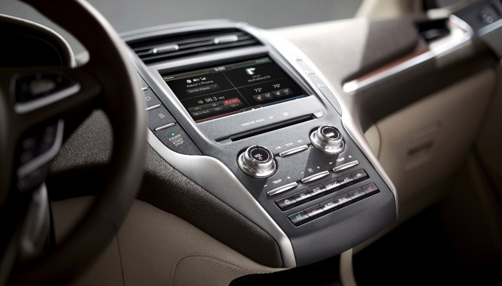 Notice push-to-start button is immediately below the bush-button gear selector in 2015 MKC