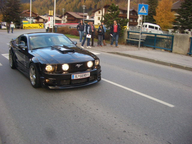 It might be small, but a strong Mustang fan and owner base already exists in Europe. Pictured here, a black fifth-gen S197 Mustang GT accelerates on a German road as onlookers watch.