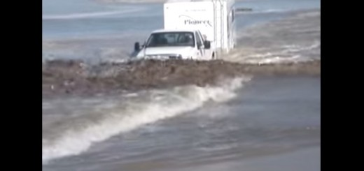 Ford Super Duty Power Stroke hauls trailer thru ocean