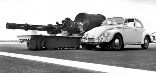 Volkswagen Beetle Type 1 next to a General Electric GAU-8 Gatling gun, from an A-10 Thunderbolt II. The A-10 has no relation to Volkswagen, nor to the Allied WWII war effort. Photo: U.S. Air Force