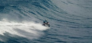 Robbie Madison riding a dirt bike on the ocean