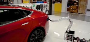 Tesla Model S with robotic snake charger